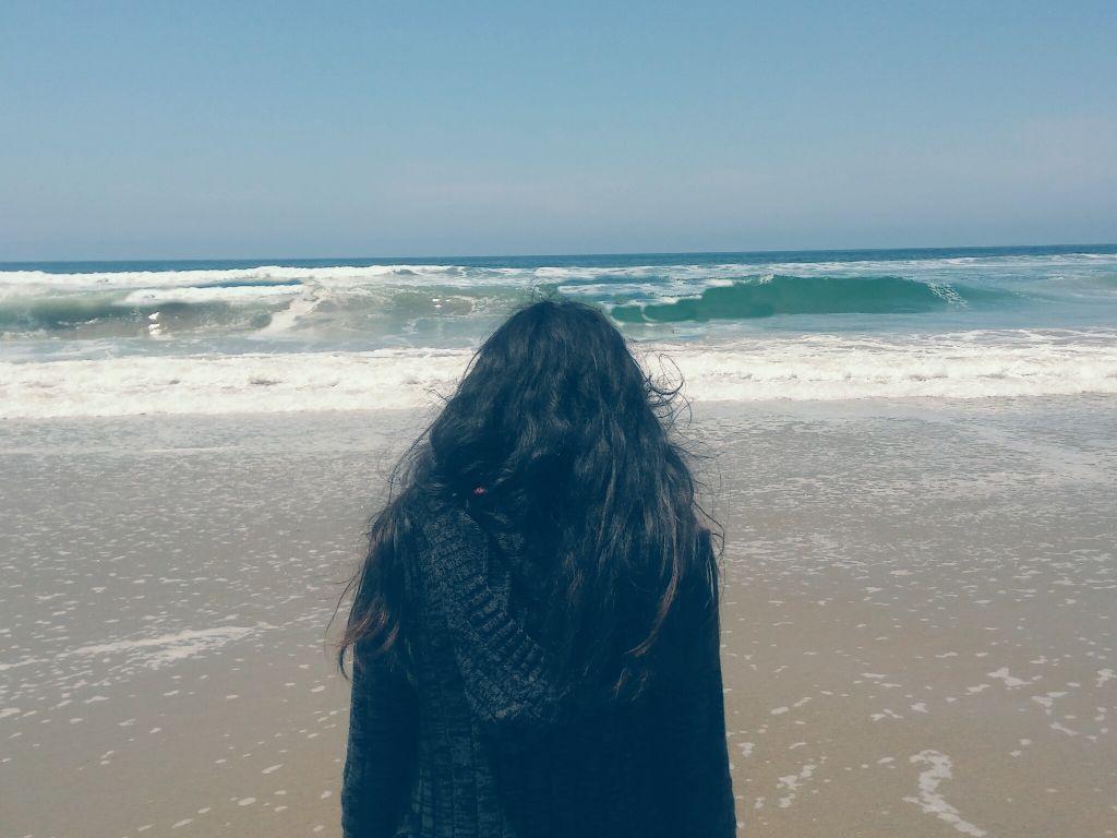 Girl alone on beach